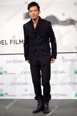 Chinese Actor Wallace Chung Poses During a Photocall For 'Duzhan' (drug War) at the Seventh Annual International Rome Film Festival in Rome Italy 15 November 2012 the Movie is Presented in Competition at the Festival That Runs From 09 to 17 November Italy Rome