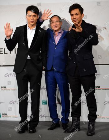 (l-r) Chinese Actor Gao Yun Xiang Director Johnnie to and Actor Wallace Chung Pose During a Photocall For 'Duzhan' (drug War) at the Seventh Annual International Rome Film Festival in Rome Italy 15 November 2012 the Movie is Presented in Competition at the Festival That Runs From 09 to 17 November Italy Rome