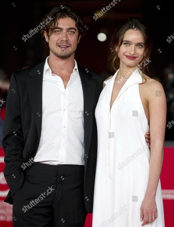 Stock Picture of Italian Actor Riccardo Scamarcio (l) and Actress Clara Ponsot (r) Arrive For the Premiere of 'Cosimo E Nicole' at the Seventh International Rome Film Festival in Rome Italy 16 November 2012 the Festival Runs From 09 to 17 November Italy Rome