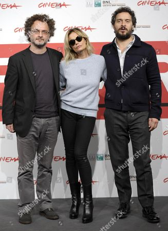 (l-r) Italian Director Antonio Morabito and Italian Actors Isabella Ferrari and Claudio Santamaria Pose During the Photocall For 'The Medicine Seller (il Venditore Di Medicine)' at the 8th Annual Rome Film Festival in Rome Italy 11 November 2013 the Movie is Presented in out Competition at the Festival That Runs From 08 to 17 November Italy Rome