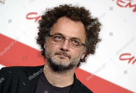 Stock Photo of Italian Director Antonio Morabito Poses During the Photocall For 'The Medicine Seller (il Venditore Di Medicine)' at the 8th Annual Rome Film Festival in Rome Italy 11 November 2013 the Movie is Presented in out Competition at the Festival That Runs From 08 to 17 November Italy Rome