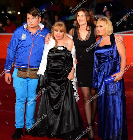 (l-r) Italian Actor Daniele Acciobanidei Romanian Actress Marianna Dadiloveanu Italian Director Elisa Amoruso and Italian Cast Member Giuseppe/beatrice Della Pelle Arrive For the Premiere of 'Fuoristrada' at the 8th Annual Rome Film Festival in Rome Italy 15 November 2013 the Movie is Presented out of Competition at the Festival That Runs From 08 to 17 November Italy Rome