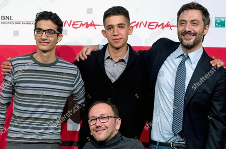 Stock Picture of (l-r) Actor Farouk Abdalla Italian Director Mirko Locatelli (down) Actors Jaouher Brahim and Filippo Timi Pose During the Photocall For the Movie 'I Corpi Estranei' (foreign Bodies) at the 8th International Rome Film Festival in Rome Italy 12 November 2013 the Movie is Presented in the Official Competition at the Festival That Runs From 08 to 17 November Italy Rome