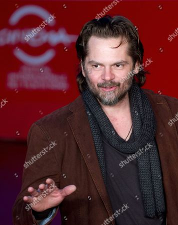 Romanian Actor/cast Member Florin Piersic Jr Poses on the Red Carpet at Rome's Park of the Music Auditorium As He Arrives For the Screening of the Movie 'Quod Erat Demostrandum' at the 8th Annual Rome Film Festival in Rome Italy 12 November 2013 the Movie is Presented in the Official Competition at the Festival That Runs From 08 to 17 November Italy Rome