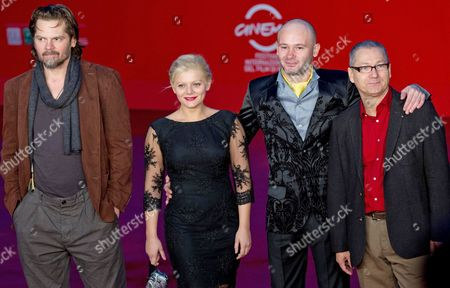 (l-r) Romanian Actor/cast Members Florin Piersic Jr Poses with Compatriots Actress Ofelia Popii Actor Sorin Leoveanu and Director Andrei Gruzsniczki on the Red Carpet at Rome's Park of the Music Auditorium As They Arrive For the Screening of the Movie 'Quod Erat Demostrandum' at the 8th Annual Rome Film Festival in Rome Italy 12 November 2013 the Movie is Presented in the Official Competition at the Festival That Runs From 08 to 17 November Italy Rome