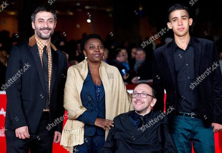 Italian Actor Filippo Timi Italian Minister of Integration Cecile Kyenge Italian Director Mirko Locatelli and Actor Jaouher Brahim Pose on the Red Carpet at Rome's Park of the Music Auditorium As He Arrives For the Screening of the Movie 'I Corpi Estranei' (foreign Bodies) at the 8th Annual Rome Film Festival in Rome Italy 12 November 2013 the Movie is Presented in the Official Competition at the Festival That Runs From 08 to 17 November Italy Rome