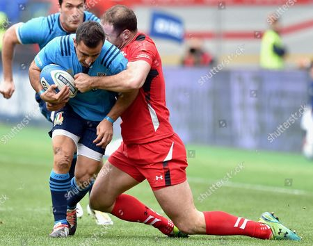 Italy's Luciano Orquera (l) in Action Against Wales' Jamie Roberts During the Six Nations Rugby Match Between Italy and Wales at Olimpico Stadium in Rome Italy 21 March 2015 Italy Rome