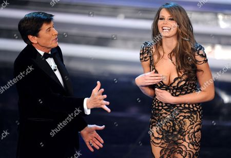 Italian Pop Singer and Entertainer Gianni Morandi (l) is Seen with Czech Fashion Model Ivana Mrazova (r) on Stage at Ariston Theatre During the Final Day of Sanremo Festival in Sanremo Italy 18 February 2012 Italy Sanremo