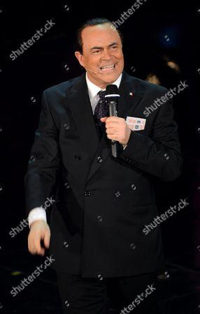 Italian Satirist Maurizio Crozza Caricatures Former Italian Prime Minister Silvio Berlusconi During the Opening Night of Sanremo Italian Song Festival on the Stage of Ariston Theatre in Sanremo Italy 12 February 2013 the Festival Runs From 12 to 16 February Italy Sanremo