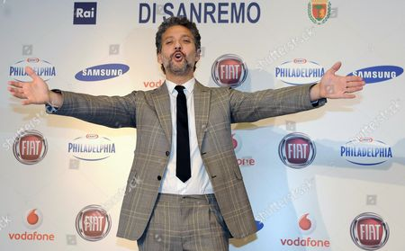 Italian Actor Beppe Fiorello Gestures During a Photocall in the Press Room of the Ariston Theatre in Sanremo Italy 13 February 2013 the Sanremo Italian Song Festival Runs Until 16 February Italy Sanremo
