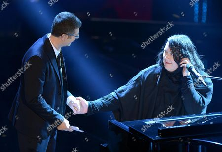 British Singer Antony Hegarty (r) with Italian Host Fabio Fazio (l) During the Third Night of the 63rd Sanremo Italian Song Festival at the Ariston Theatre in Sanremo Italy 14 February 2013 the Sanremo Italian Song Festival Runs From 12 to 16 February Italy Sanremo