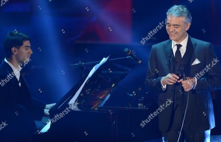 Italian Singer Andrea Bocelli (r) Performs with His Son Amos on Piano During the Final Night of the 63rd Sanremo Italian Song Festival at the Ariston Theatre in Sanremo Italy 16 February 2013 Italy Sanremo