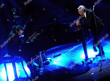 Brazilian Composer Singer and Guitarist Caetano Veloso Performs with Italian Jazz Pianist Stefano Bollani (l) During the Fourth Night of the 63rd Sanremo Italian Song Festival at the Ariston Theatre in Sanremo Italy 15 February 2013 the Sanremo Italian Song Festival Runs From 12 to 16 February Italy Sanremo
