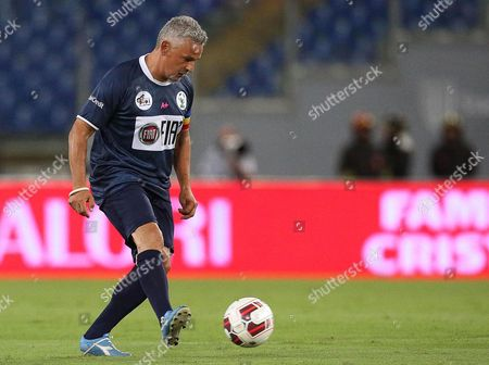 Former Italian Player Roberto Baggio in Action During the Interreligious 'Match For Peace' at the Olimpico Stadium in Rome Italy 01 September 2014 the Match Has Been Organised by Pope Francis Upon the Pope's Appeals For an End to Conflicts Around the World Italy Rome