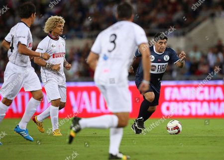 Argentinian Soccer Legend Diego Armando Maradona (r) and Former Colombian Player Carlos Valderrama (2-l) in Action During the Interreligious 'Match For Peace' at the Olimpico Stadium in Rome Italy 01 September 2014 the Match Has Been Organised by Pope Francis Upon the Pope's Appeals For an End to Conflicts Around the World Italy Rome