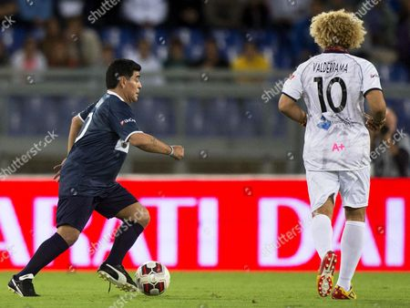 Argentinian Soccer Legend Diego Armando Maradona (l) and Former Colombian Player Carlos Valderrama (r) in Action During the Interreligious 'Match For Peace' at the Olimpico Stadium in Rome Italy 01 September 2014 the Match Has Been Organised by Pope Francis Upon the Pope's Appeals For an End to Conflicts Around the World Italy Rome