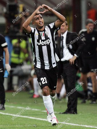 Chilean Midfielder of Fc Juventus Arturo Vidal Jubilates After Scoring the 2-1 Against Ac Milan at the Giuseppe Meazza Stadium in Milan where They Were Playing For the Luigi Berlusconi Trophy 19 August 2012 Italy Milan