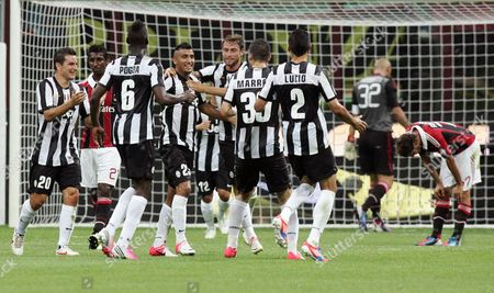 Chilean Midfielder of Fc Juventus Arturo Vidal (4-l) is Cheered by Team Mates As They Celebrate Him After Scoring the 2-1 Against Ac Milan at the Giuseppe Meazza Stadium in Milan where They Were Playing For the Luigi Berlusconi Trophy 19 August 2012 Italy Milan