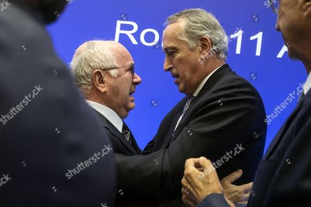 New Italian Football Federation (figc) President Carlo Tavecchio (l) Embraces Outgoing President Giancarlo Abete After His Election in Rome Italy 11 August 2014 Italy Rome