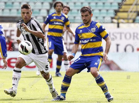 Stock Picture of Siena's Midfielder Adrian Daniel Calello (l) in Action Against Parma's Midfielder Sotiris Ninis (r) During the Italian Serie a Soccer Match Between Ac Siena and Parma Fc at Artemio Franchi Stadium in Siena Italy 07 April 2013 Italy Siena