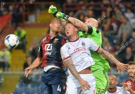 Genoa's Sebastien De Maio (l) with Ac Milan's Philippe Mexes and Christian Abbiati (r) Go For the Ball During the Italian Serie a Soccer Between Genoa and Ac Milan at the Luigi Ferraris Stadium in Genoa Italy 07 April 2014 Italy Genoa