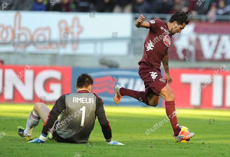 Torino's Argentinian Midfielder Mario Santana (r) Scores the 1-0 Lead Against Milan Goalkeeper Marco Amelia (l) During the Italian Serie a Soccer Match Between Torino Fc and Ac Milan at the Olimpic Stadium in Turin Italy 09 December 2012 Italy Turin