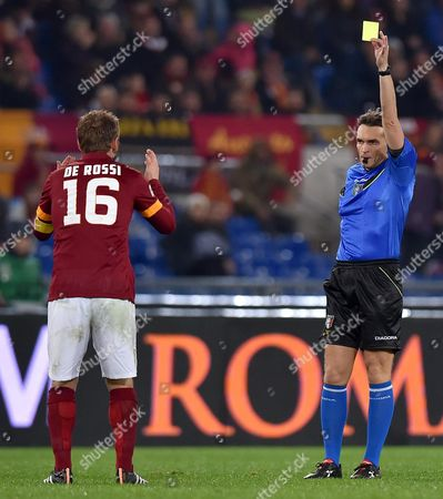As Roma's Daniele De Rossi (l) Receives the Second Yellow Card and is Sent Off the Pitch From Referee Massimiliano Irrati During the Serie a Soccer Match Between As Roma and Sassuolo at the Olimpico Stadium in Rome Italy 06 December 2014 Italy Rome