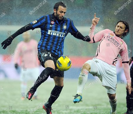 Inter Milan Forward Gianpaolo Pazzini (l) Vies For the Ball with Palermo Paraguaian Midfielder Edgar Osvaldo Barreto (r) During Italian Serie a Soccer Match Between Inter Milan and Palermo at the Giuseppe Meazza Stadium in Milan Italy 01 February 2012 Italy Milan