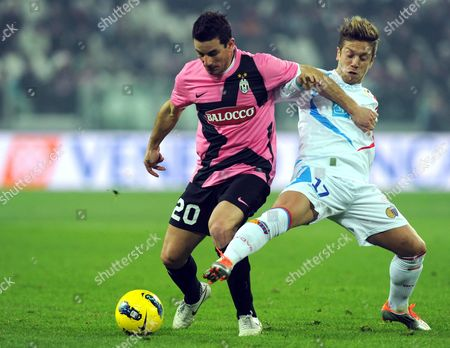 Simone Padoin (l) of Juventus Vies For the Ball with Catania's Alejandro Dario Gomez (r) During the Italian Serie a Soccer Match Between Juventus Fc and Catania Calcio at the Juventus Stadium in Turin Italy 18 February 2012 Italy Turin