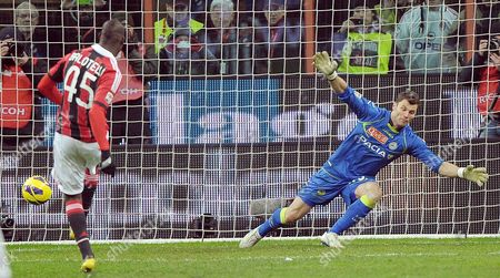 A C Milan Goalkeeprer Marco Amelia (r) is Challenged For the Ball by Udinese Defender Maurizio Domizzi During Their Serie a Soccer Match at the Giuseppe Meazza Stadium in Milan Italy 03 February 2013 Italy Milan