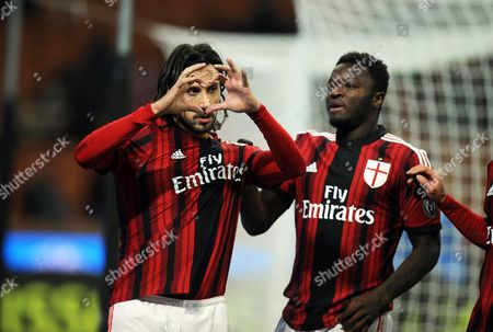 Milan's Cristian Zaccardo (l) Celebrates with Teammate Sulley Muntari (r) After Scoring the 3-1 Goal During Italian Serie a Soccer Match Between Ac Milan and Parma Fc at Giuseppe Meazza Stadium in Milan Italy 01 February 2015 Italy Milan
