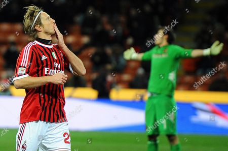 Milan's Italian Midfielder Massimo Ambrosini (l) Celebrates After Scoring the 3-0 Lead Against Cagliari's Goalkeeper Michael Agazzi (r) During the Italian Serie a Soccer Match Between Ac Milan and Cagliari Calcio at Giuseppe Meazza Stadium in Milan Italy 29 January 2012 Italy Milan