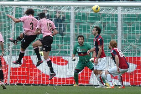Palermo's Defender Matias Augustin Silvestre (l) Scores Against Genoa's Goalkeeper Sebastien Frey (c) During Their Serie a Soccer Match in Palermo Italy 22 January 2012 Italy Palermo