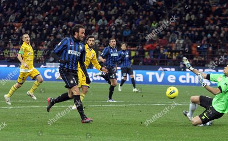 Inter Milan's Forward Gianpaolo Pazzini (l) Scores the 4-0 During the Serie a Soccer Match Between Inter Milan and Fc Parma at the Giuseppe Meazza Stadium in Milan Italy 07 January 2012 Italy Milan