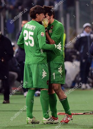Cagliari's Goalkeeper Michael Agazzi (r) Whispers to His Teammate Vlada Avramov (l) Before Leaving the Field During the Italian Serie a Soccer Match Between Ss Lazio and Cagliari Calcio at the Olympic Stadium in Rome Italy 05 January 2013 Italy Rome
