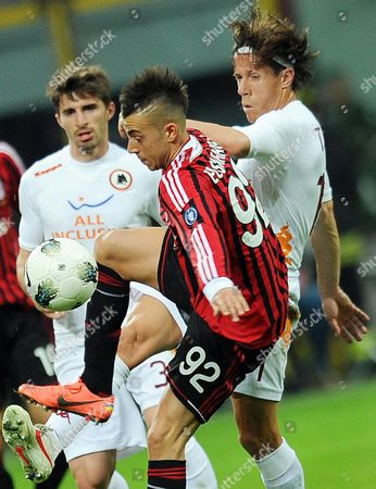 Milan's Stephan El Shaarawy (l) Vies For the Ball with Roma's Rodrigo Taddei (r) During the Italian Serie a Soccer Match Between Ac Milan and As Roma at Giuseppe Meazza Stadium in Milan Italy 24 March 2012 Italy Milan