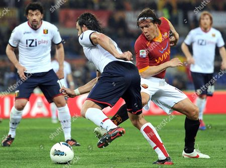 As Roma's Rodrigo Taddei (r) in Action Against Cfc Genoa's Alberto Gilardino During the Serie a Soccer Match Between As Roma and Cfc Genoa at the Olimpico Stadium in Rome Italy 19 March 2012 Italy Rome