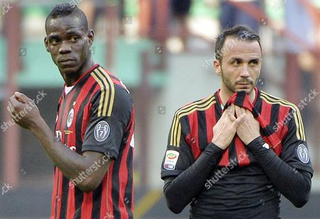 Ac Milan's Forwards Mario Balotelli (l) and Gianpaolo Pazzini React During the Serie a Soccer Match Between Ac Milan and Parma at the Giuseppe Meazza Stadium in Milan Italy 16 March 2014 Italy Milan