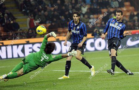 Inter Milan Midfielder Thiago Motta (r) Scores the 1-0 Lead Against Cagliari Calcio Goalkeeper Michael Agazzi (l) During Their Italian Serie a Soccer Match at the Giuseppe Meazza Stadium in Milan Italy 19 November 2011 Italy Milan