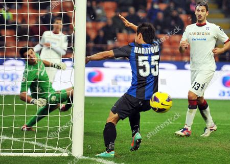 Inter Milan's Japanese Defender Yuto Nagatomo (c) Fails to Score Against Cagliari Goalkeeper Michael Agazzi (r) During the Italian Serie a Soccer Match Between Inter Milan and Cagliari Calcio at Giuseppe Meazza Stadium in Milan Italy 18 November 2012 the Match Ended 2-2 Italy Milan