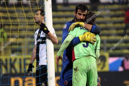Bologna's Goalkeeper Gianluca Curci Celebrates with His Teammates at the End of the Italian Serie a Soccer Match Between Parma Fc and Bologna Fc at Ennio Tardini Stadium in Parma Italy 30 November 2013 Italy Parma