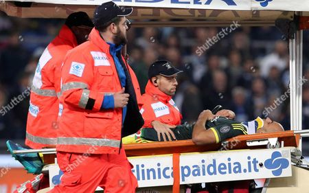 Stock Image of Milan's Alex Rodrigo Dias Da Costa is Taken Off the Field After Being Injured During the Italian Serie a Soccer Match Ss Lazio Vs Ac Milan at Olimpico Stadium in Rome Italy 01 November 2015 Italy Rome