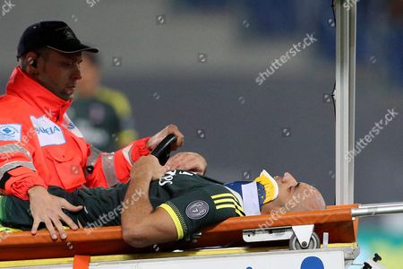 Stock Picture of Milan's Alex Rodrigo Dias Da Costa is Taken Off the Field After Being Injured During the Italian Serie a Soccer Match Ss Lazio Vs Ac Milan at Olimpico Stadium in Rome Italy 01 November 2015 Italy Rome