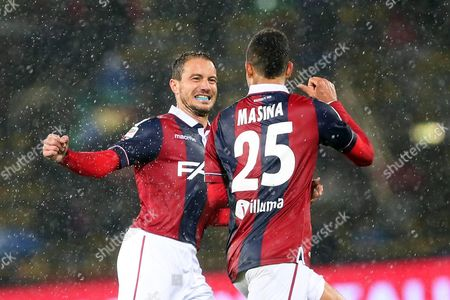 Bologna's Defender Adam Masina (r) Celebrates with His Teammate Matteo Brighi (l) After Scoring the 1-0 Lead During the Italian Serie a Soccer Match Between Bologna Fc and As Roma at Renato Dall'ara Stadium in Bologna Italy 21 November 2015 Italy Bologna