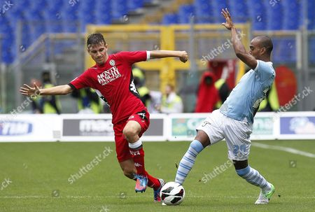 Lazio's Abdoulay Konko (r) Vies For the Ball with Siena's Valerio Verre (l) During the Italian Serie a Soccer Match Between Ss Lazio and Ac Siena at Olimpico Stadium in Rome Italy 30 September 2012 Italy Rome