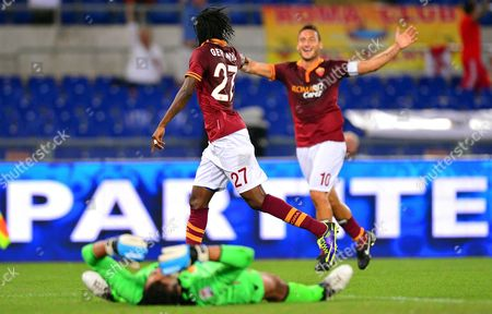 As Roma's Gervinho (l) Celebrates with His Teammate Francesco Totti (r) After Scoring the 2-0 Lead During the Italian Serie a Soccer Match Between As Roma and Bologna Fc at the Olimpico Stadium in Rome Italy 29 September 2013 in Foreground Bologna's Goalkeeper Gianluca Curci Italy Rome