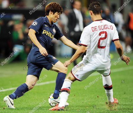 Psv Eindhoven's Midfielder Ji-sung Park (l) in Action Against Ac Milan's Defender Mattia De Sciglio (r) During the Uefa Champions League Playoff Second Leg Soccer Match Between Ac Milan and Psv Eindhoven at Giuseppe Meazza Stadium in Milan Italy 28 August 2013 Italy Milan