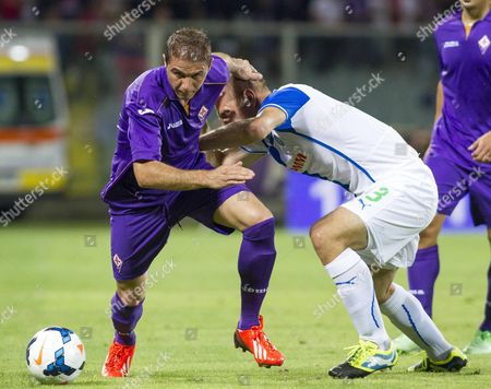 Joaquin (l) of Fiorentina and Stephane Grichting of Grasshopper in Action During the Uefa Europa League Play-off Second Leg Match Acf Fiorentina Vs Grasshopper Club Zurich at Artemio Franchi Stadium in Florence Italy 29 August 2013 Italy Florence