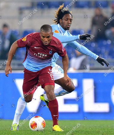 Ss Lazio's Luis Cavanda (r) in Action Against Trabzonspor's Florent Malouda (l) During the Uefa Europa League Group J Soccer Match Between Ss Lazio and Trabzonspor at the Olimpico Stadium in Rome Italy 12 December 2013 Italy Rome