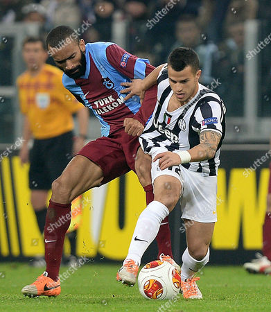 Juventus' Sebastian Giovinco (r) and Trabzonspor's Jose Bosingwa in Action During the Uefa Europa League Soccer Match Between Juventus Fc and Trabzonspor at Juventus Stadium in Turin Italy 20 February 2014 Italy Turin